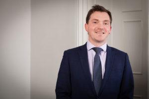 an image of Alex Sandland, a Butcher & Barlow LLP employee